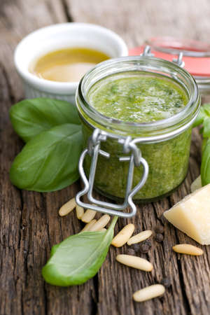 Fresh gree pesto in a preserving glass photo