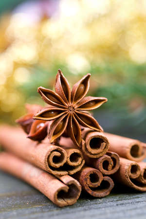 christmas perfume: Christmas spices on wooden ground Stock Photo