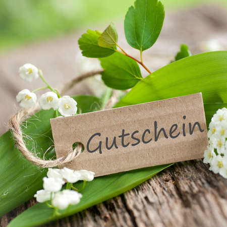 Label mit Deutsch Text Gutschein - Gutschein