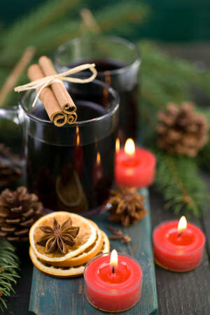 Hot spiced wine on wooden ground photo