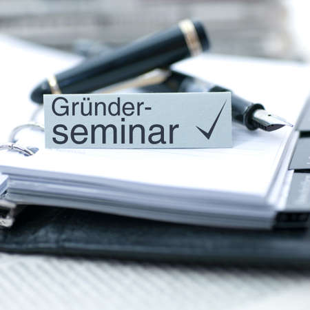 feasibility: Label with german text  Founder seminar Stock Photo