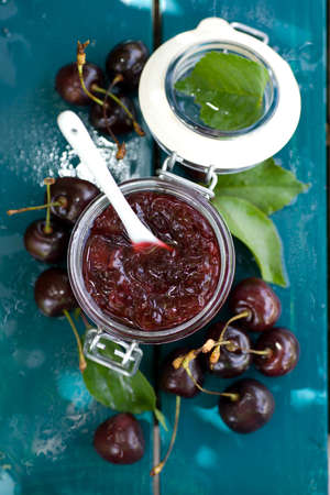 sour cherry: Fresh cherry jam in a preserving glass
