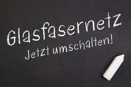 optical fiber: Chalkboard with german text  Optical fiber network Stock Photo
