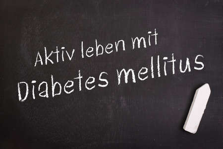 Slate with german text  Active life with diabetes photo