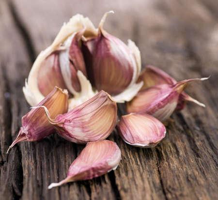 herbal knowledge: Fresh garlic on wooden ground