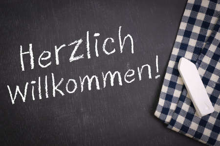 Chalkboard with german text  Welcome Stock Photo - 17994528