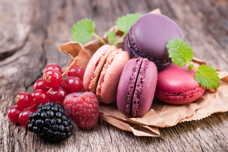 Macaroons with berries Stock Photo