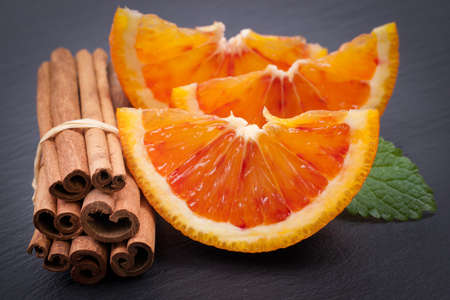 Blood oranges and cinnamon sticks  Stock Photo
