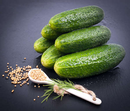 dill seed: Fresh gherkins Stock Photo