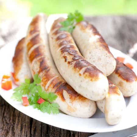 bratwurst: Fried sausage on a plate