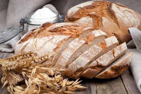 brown  bread: Fresh bread on wooden ground