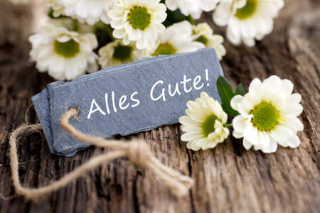 Label with German text: all the best