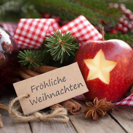Label with German text: Merry Christmas Zdjęcie Seryjne