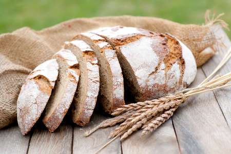 Fresh bread on wooden table Zdjęcie Seryjne