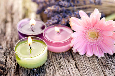 Candles, Flowers on wooden table