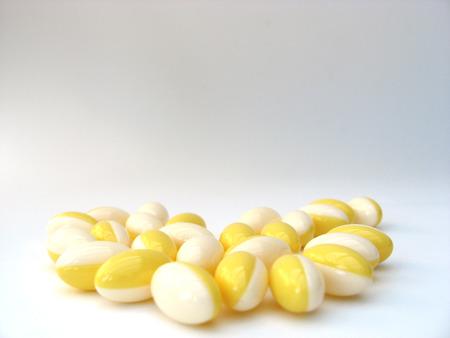 white & yellow pills Stock Photo - 1692763