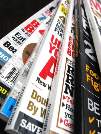 pile of newspapers: magazines