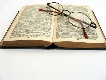 a book and glasses on a plain background Stock Photo - 1849880