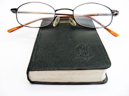 closed book and glasses on a white background Stock Photo - 1849869