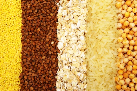 Various kinds of groats are spread out by numbers: a buckwheat, rice, peas, oat-flakes, groats photo