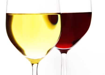Two wine glasses of wine on a white background red and white on a white background