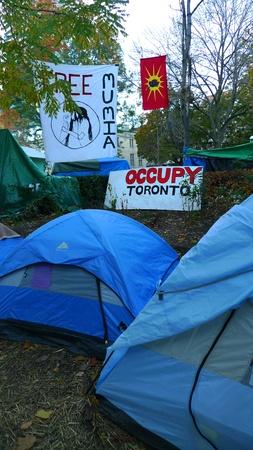 tent city: TORONTO - NOVEMBER 05: Tents of Occupy Toronto at St. James Park on Nov 05, 2011 in Toronto, Canada