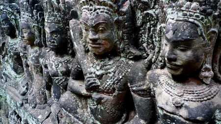 heads old building facade: Closeup of ancient bas relief at Angkor Thom, Cambodia