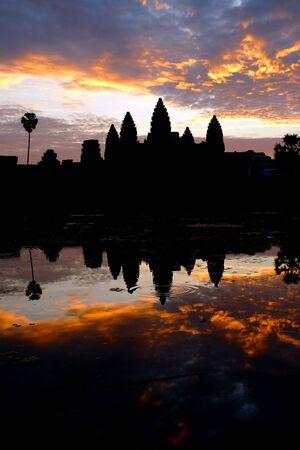 angkor wat: Dramatic sunrise at Angkor Wat and reflecting pool, near Siem Reap, Cambodia