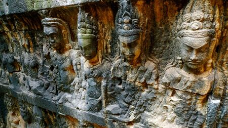 Bas relief of religious figures at Angkor Thom, near Siem Reap, Cambodia