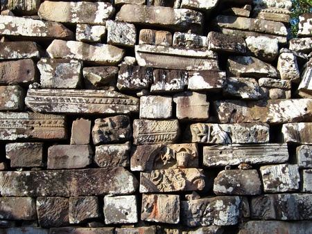 Ancient bricks of Bayon Temple, Angkor, Cambodia photo