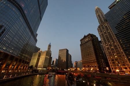 Buildings along Chicago River at sunset photo