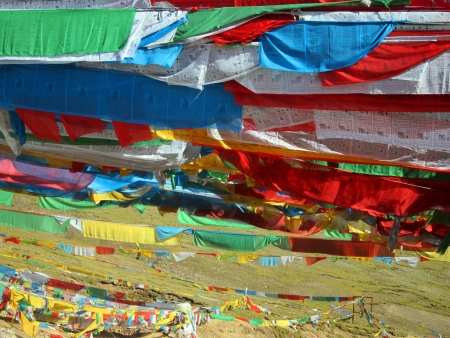 Lama Buddhist prayer flags in the highlands of Tibet Stock Photo