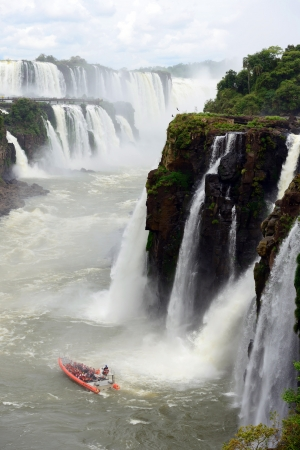 Iguazu Falls, the famous waterfall in the world at the border of Argentina and Brazil photo