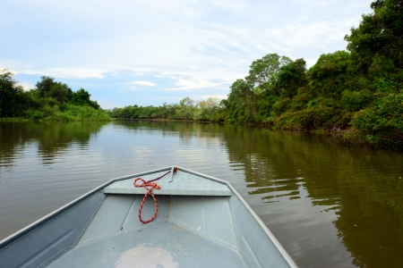 Tourist boat for river safari in Pantanal, Mato Grosso, Brazil photo