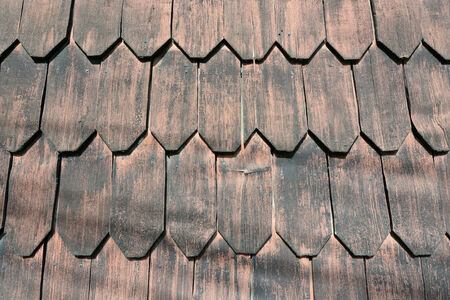Beautiful wood shingles of traditional houses on Chiloe Island in Chile photo