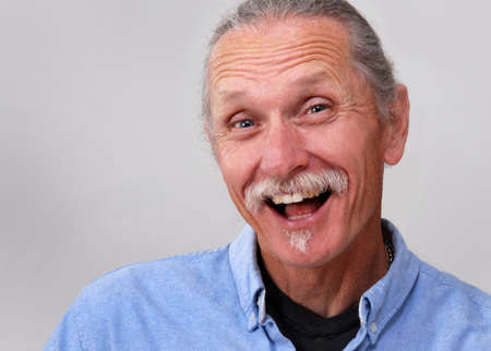 exuberant: Exuberant middle aged man, white background.