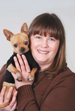 spay: Woman holding Chihuahua