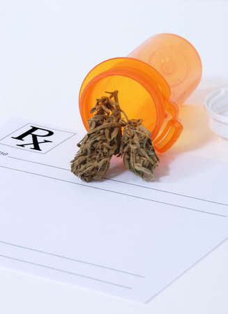 Cannabis bud sitting on a prescription pad photo