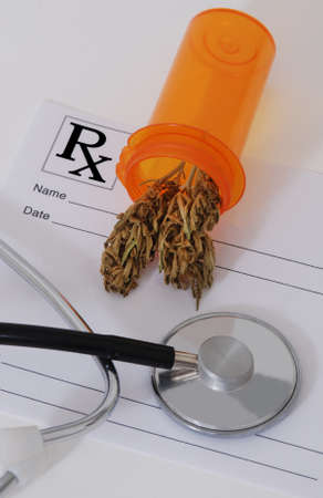 Cannabis bud sitting on a prescription pad, near a stethoscope photo