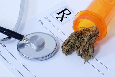 Cannabis bud sitting on a prescription pad, near a stethoscope