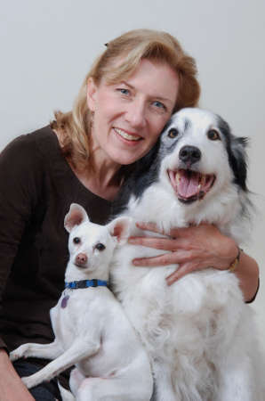 Smiling woman with two dogs