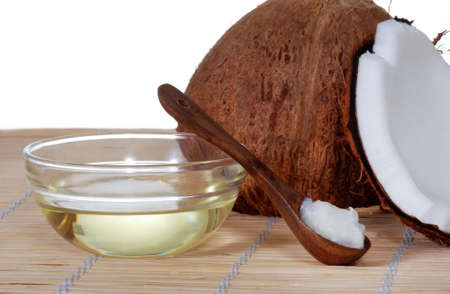 coconut palm: Coconut oil on a bamboo mat Stock Photo