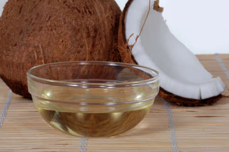 Coconut oil on a bamboo mat Stock Photo