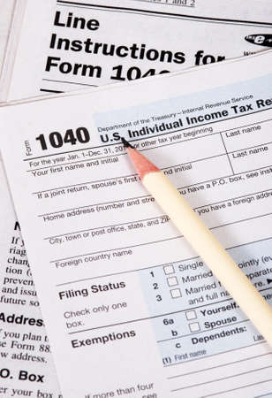 Close up of United States tax form, instruction book and pencil