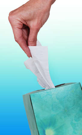 Hand pulling tissue out of box. Stock Photo - 13338974