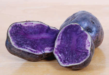 Close up of blue potatoes, sliced in half