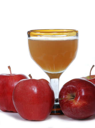 unfiltered: Red apples with a glass of unfiltered organic apple juice