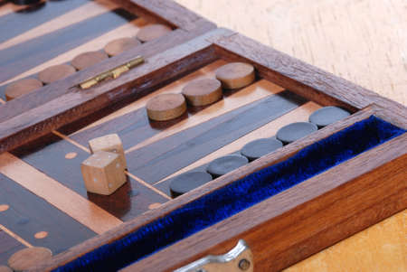 Wooden Backgammon boardgame with dice.   photo