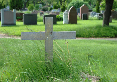 Simple wooden cross in an outdoor cemetery  photo
