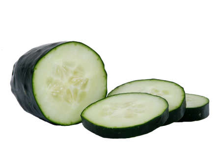 Fresh cucumber slices. Isolated on white. photo